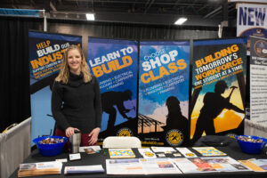 one person standing in front of careers in construction booth