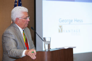 George Hess speaking at an event