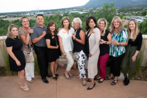 10 people posing for a picture on patio overlook